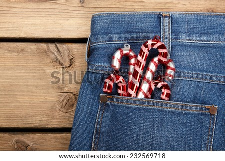 candy canes in blue jean pocket  - stock photo