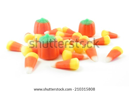 Candy corn and candy pumpkins, isolated on a white background. - stock photo