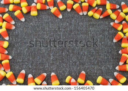 Candy Corn Frame surrounding Tweed Fabric with room or space for text or your words for Halloween or Thanksgiving - stock photo