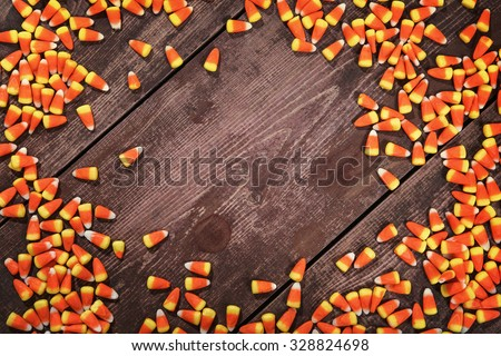 Candy corn on a wooden background - stock photo