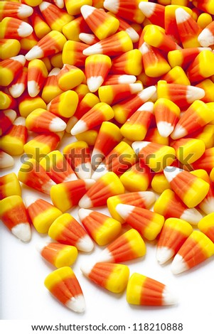 Candy corn scattered on floor. - stock photo