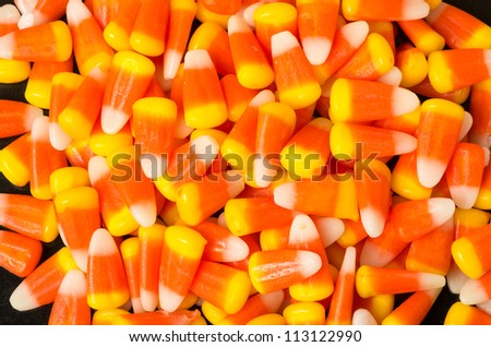 Candy corn sweets as background - stock photo