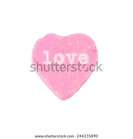 "Candy Heart Love. Pink candy heart with the word ""love"" printed on it. Valentine's Day concept. - stock photo"