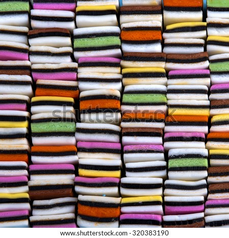 Candy variety with colourful liquorice sweets neatly organized in a square, stacked pattern - stock photo