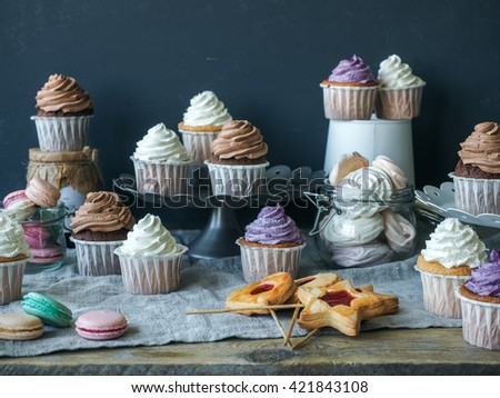 Candybar from cupcakes, macarons and cookies - stock photo