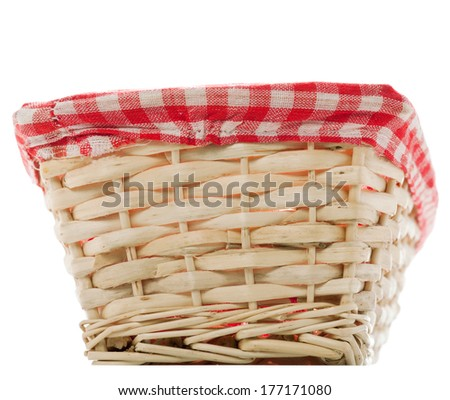 Cane bread basket with internal red and black clothe  - stock photo