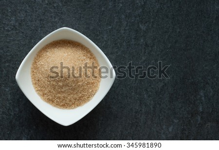 cane brown sugar in white bowl