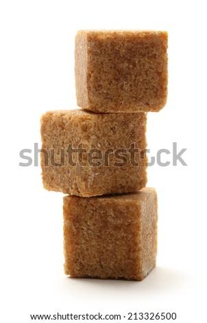 Cane sugar cubes on white background - stock photo