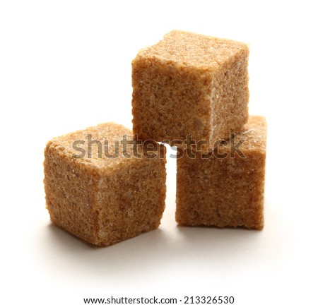 Cane sugar cubes on white background - stock photo