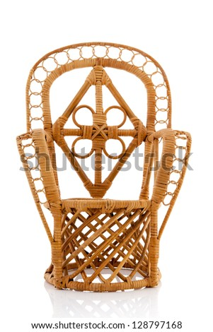 Cane wicker chair isolated over white background - stock photo