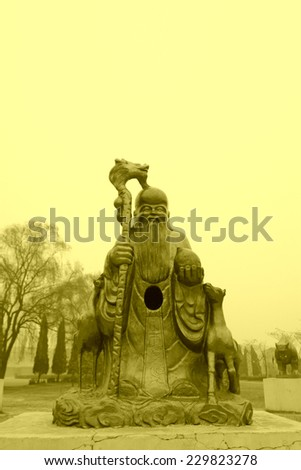 CANGZHOU - DECEMBER 8: The stone carving antarctic god man in the WuQiao acrobatics world scenic spots, on december 8, 2013, cangzhou, hebei province, China.   - stock photo