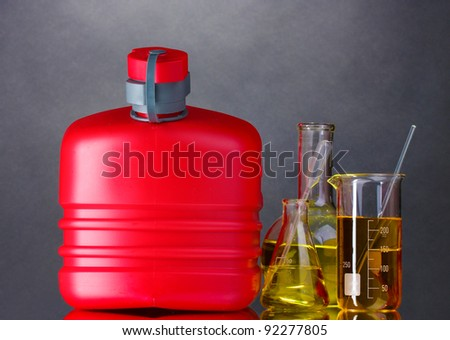 canister and fuel in test tubes on gray background