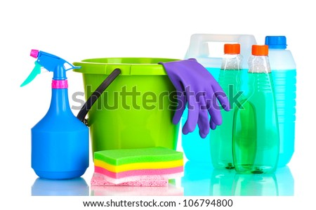 canister, detergent bottles with liquid and bucket isolated on white