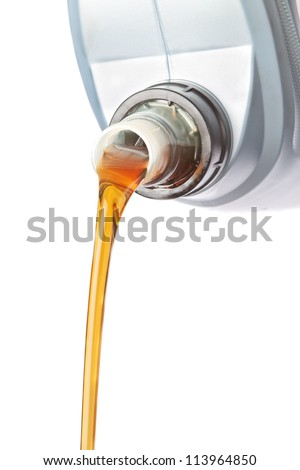 Canister of industrial oil flowing. On a white background. - stock photo
