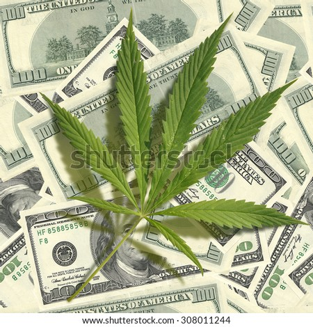 Cannabis leaf on a pile of dollars. Seamless image - stock photo