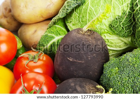 Canned and fresh vegetables isolated on white background - stock photo