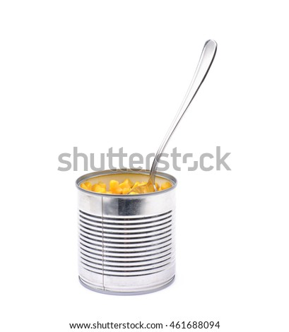 Canned corn in a tincan with a spoon in it, composition isolated over the white background