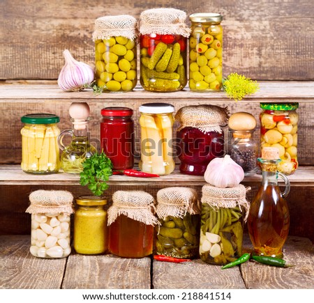 canned food on wooden background - stock photo