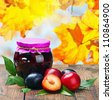 canned fruit compote and fresh plums - stock photo