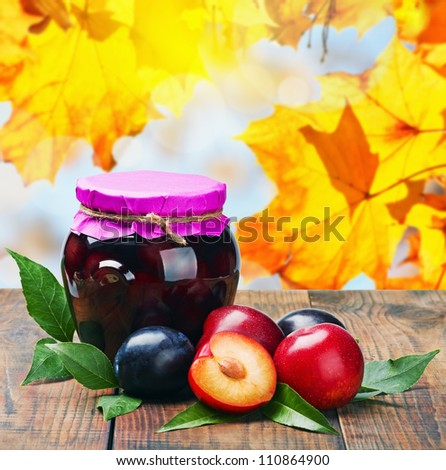 canned fruit compote and fresh plums