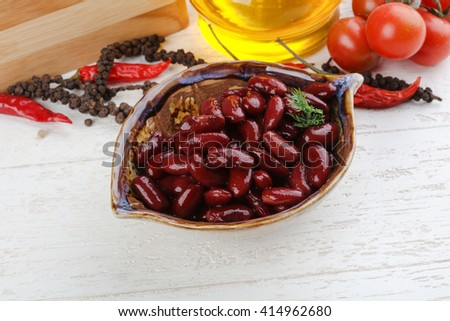 Canned kidney bean in the bowl on wood background