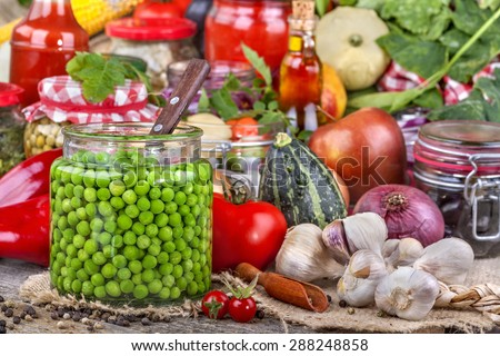 Canned peas with different fruits and vegetables in the background