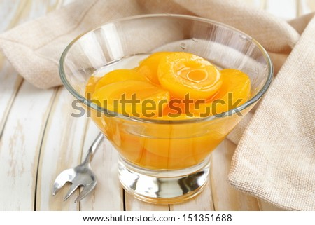 canned preserve peaches (apricots) sweet and healthy dessert - stock photo