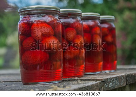 canned  strawberries on the table