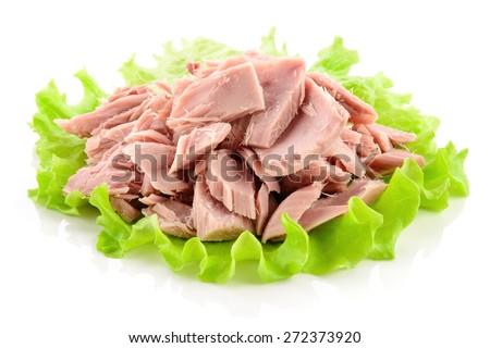 Canned tuna chunks with green salad - stock photo