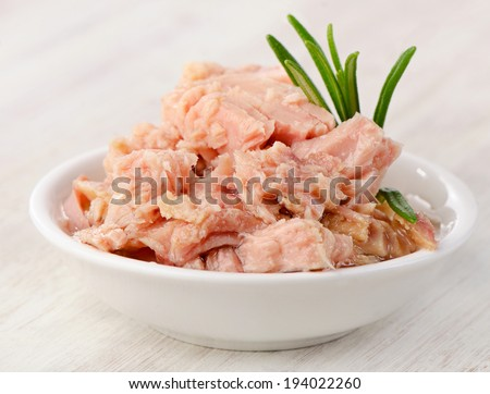 Canned tuna fish in white bowl . Selective focus - stock photo