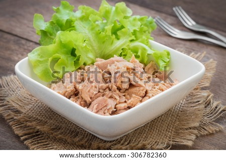 Canned tuna fish with vegetable in bowl  - stock photo