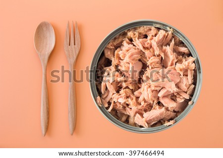 canned tuna isolated on orange background / Canned soy free albacore white meat tuna packed in water / open tuna tin on a white background / tuna fish isolated on white  - stock photo