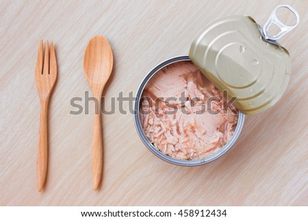 canned tuna isolated on wood background / Canned soy free albacore white meat tuna packed in water / open tuna tin on a white background / tuna fish isolated on white  - stock photo