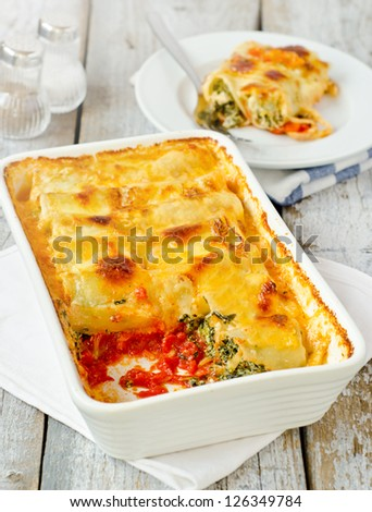 Cannelloni pasta with ricotta cheese and spinach - stock photo