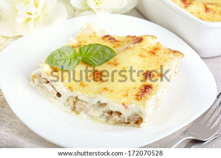 Cannelloni with chicken and mushrooms baked in sauce bechamel - stock photo