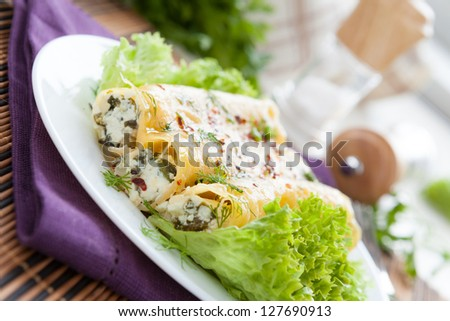 cannelloni with goat cheese and chopped greens, closeup