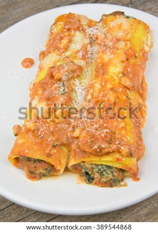 Cannelloni with tomato sauce, spinach and ricotta