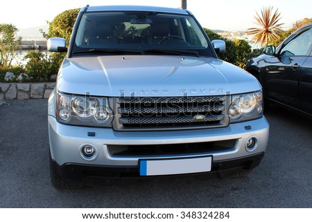 CANNES - DEC 1 : Range Rover Land Rover. Luxury British SUV Parked in the harbor of Cannes. December 1, 2015 in Cannes, France - stock photo