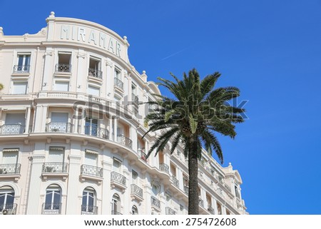 CANNES, FRANCE - APRIL 12, 2015: Tiara Miramar Beach Hotel & Spa in Cannes located at Boulevard de la Croisette in Cannes, France. - stock photo
