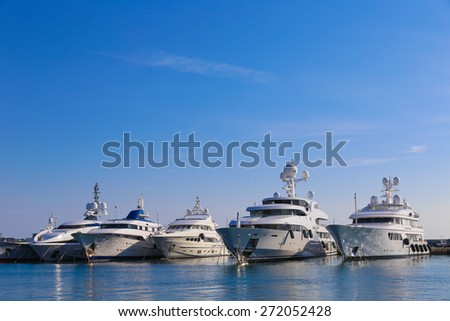CANNES, FRANCE - APRIL 12, 2015: Yachts anchored in Port Pierre Canto at the Boulevard de la Croisette in Cannes, France.  Cannes is synonymous with glamour thanks to its world-famous film festival. - stock photo