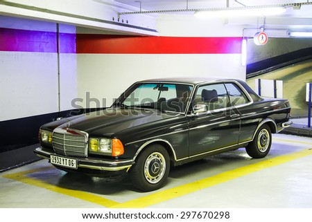 CANNES, FRANCE - AUGUST 3, 2014:Black retro car Mercedes-Benz C123 E-class at the underground parking. - stock photo