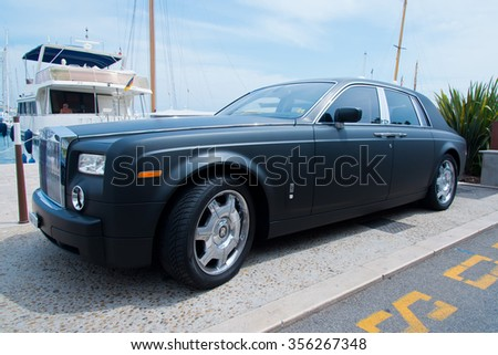 CANNES, FRANCE - AUGUST 01, 2015:  Modern Black Rolls Royce Phantom at the city street.