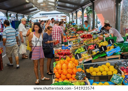 Cannes, France - August 05, 2016: Provencal market in Cannes with unidentified people. Cannes is well known for its association with the rich and famous, and the Cannes Film Festival