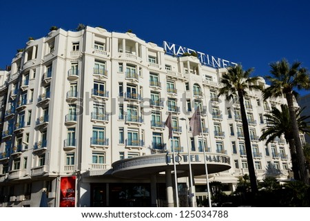 CANNES, FRANCE - JANUARY 17: Martinez facade palace shown on january 17, 2013 in Cannes, France. Martinez hotel is a luxury hotel containing 409 rooms, located in the famous film festival town. - stock photo