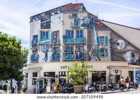 CANNES, FRANCE - JULY 10, 2014: Art painting on the wall of main Bus Station in Cannes. Cannes is a busy tourist destination and host of annual Cannes Film Festival.