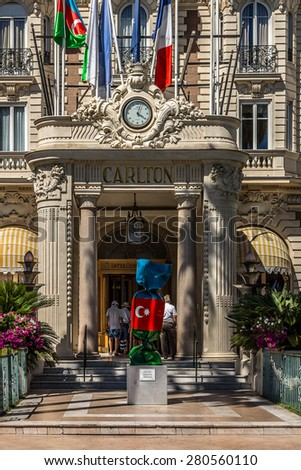 """CANNES, FRANCE - JULY 10, 2014: Luxury hotel """"Inter Continental Carlton"""" (343 rooms, built in 1911), located on the famous """"La Croisette"""" Boulevard in Cannes, French Riviera. - stock photo"""