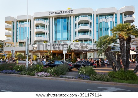 "CANNES, FRANCE - JULY 27: Luxury hotel JW Marriott, located on the famous ""La Croisette"" boulevard in Cannes, French Riviera on July 27, 2015 in Cannes, France.  - stock photo"