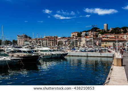 CANNES, FRANCE - JULY 10, 2014: View of Harbor and marina with moored yachts and motorboats in Cannes. Cote d'Azur. Against the background of Le Suquet- the old town of Cannes.