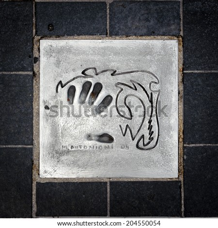 CANNES, FRANCE - JUN 25, 2014: M. Antonioni hand mark on the alley of fame in Cannes, Cote d'Azur, France