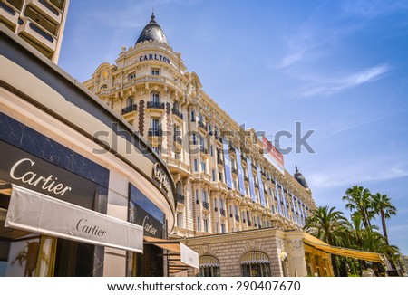 CANNES, FRANCE - JUNE 21, 2015: A general view of Hotel CARLTON CANNES and expensive shops along the Croisette. - stock photo